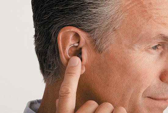 Hearing aid and middle-aged man