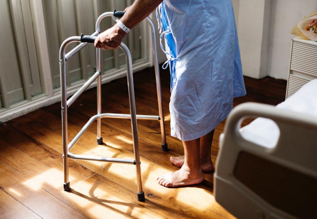 Senior with walker in elderly care