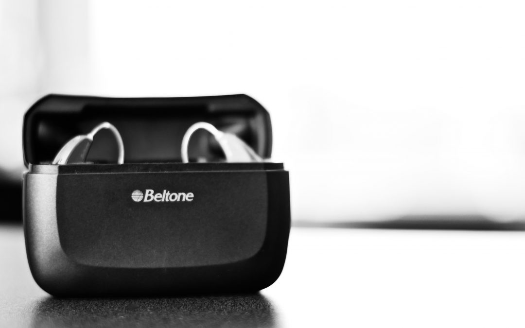 Black and white photo of Beltone hearing aids
