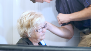 Woman receiving a free hearing test at the Abbotsford Beltone Hearing Centre location