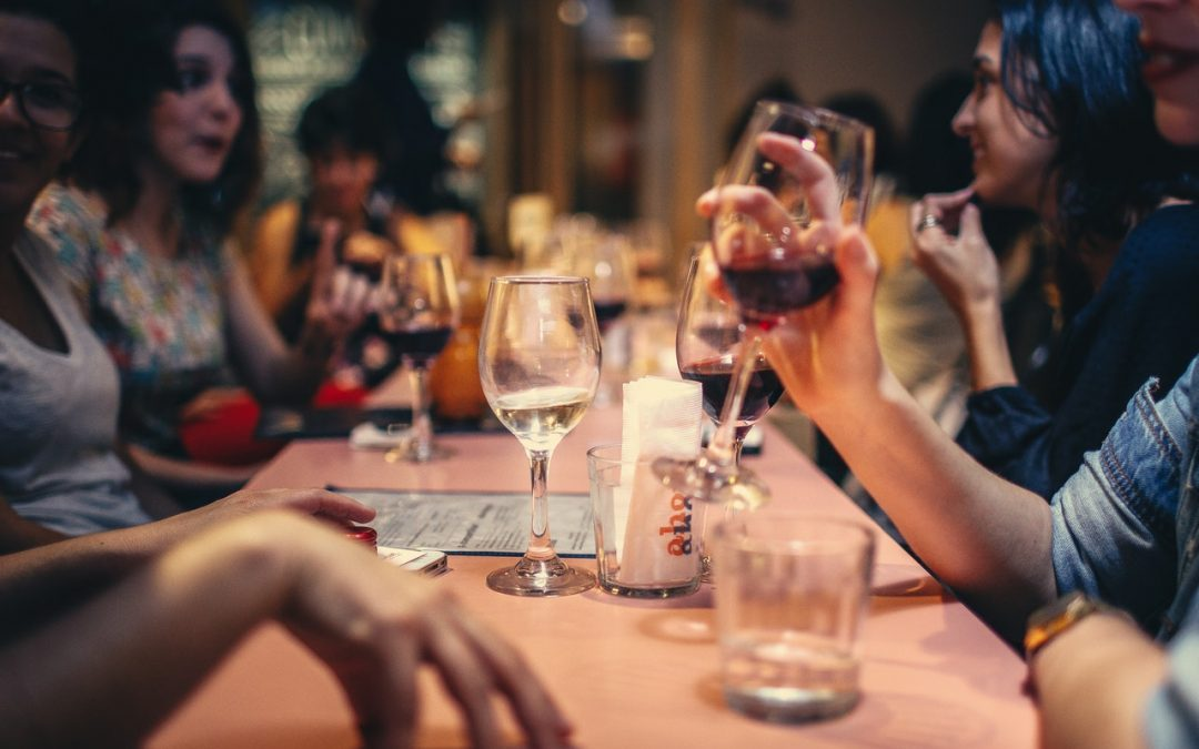 People drinking liqour and talking at a dining table