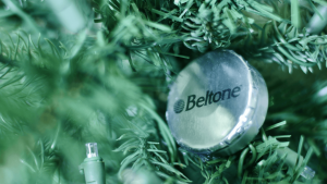 Close up picture of a Christmas truee with the Beltone logo