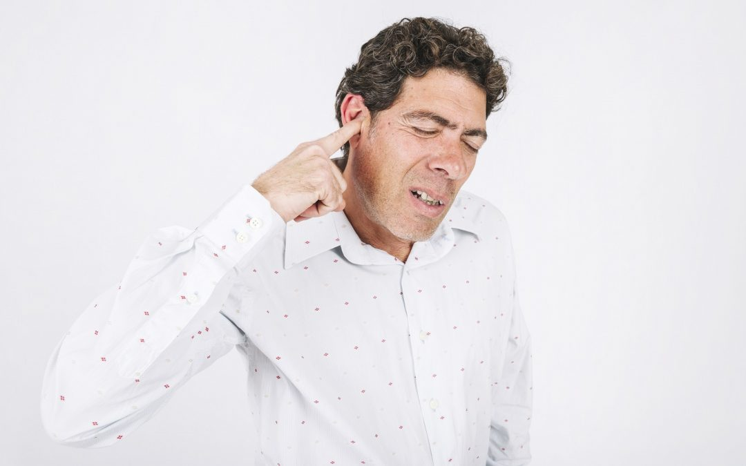 Man with hearing loss suffering from hearing recruitment