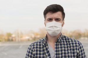 Man with hearing loss wearing a medical mask