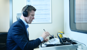 Scott Hyde performing a hearing test in Langley