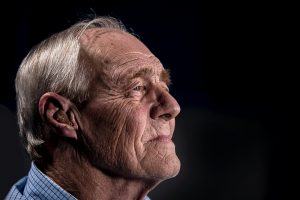 Senior man with a hearing aid