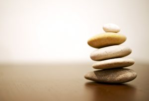 Balance Rocks on Wood Table. Stack of Round Smooth Stones.