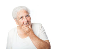 Senior woman suffering from both memory loss and hearing loss