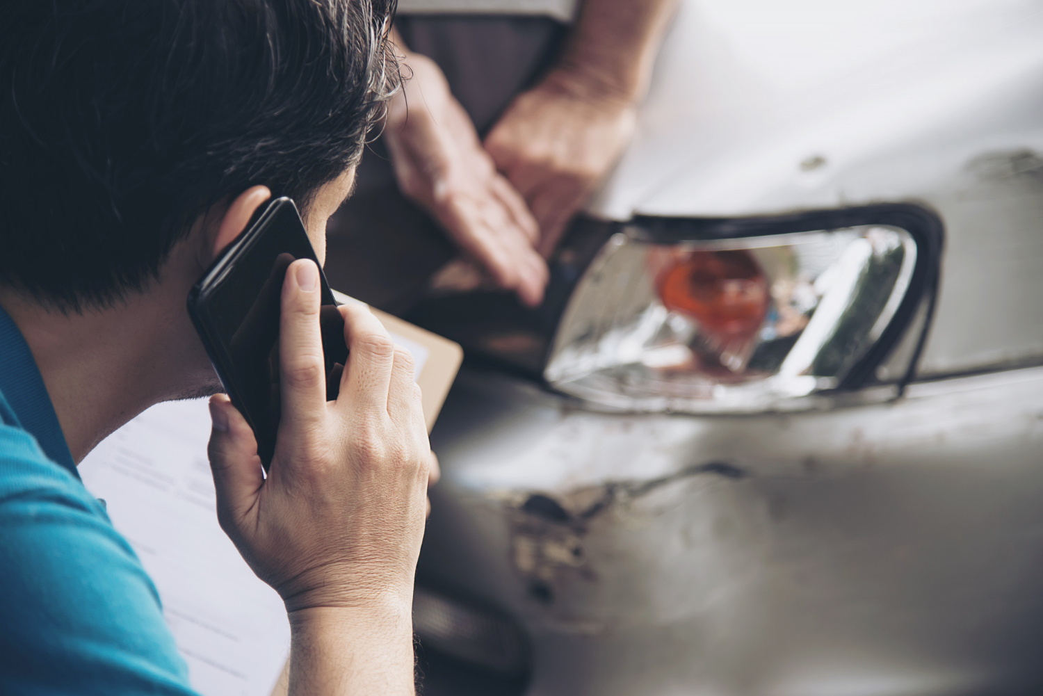 Man on phone after getting into a car accident