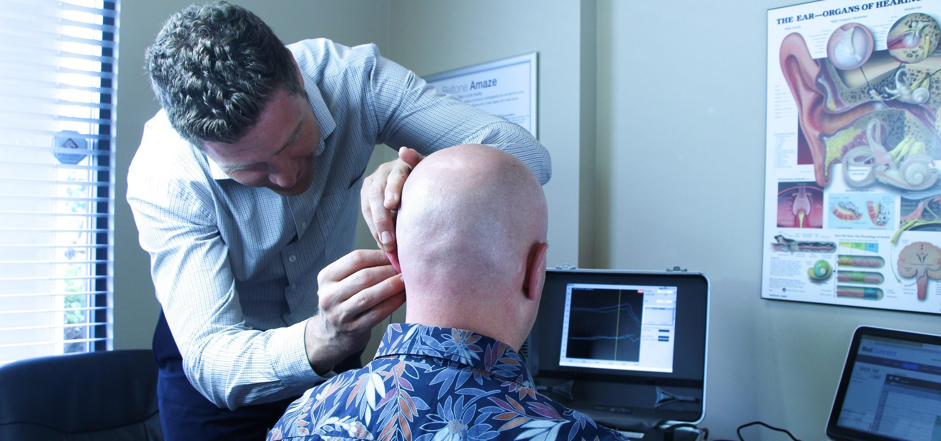 Fraser Valley Beltone customer wearing a hearing aid for the first time