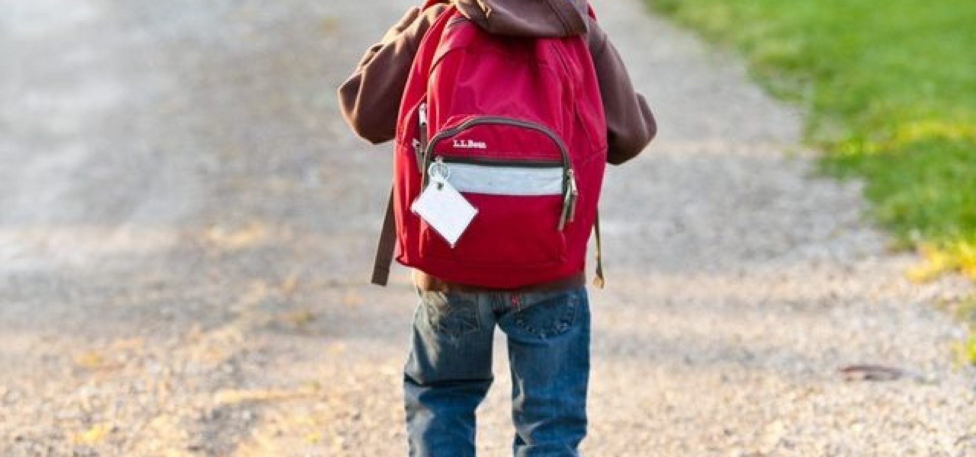 Boy walking to school wearing backpack