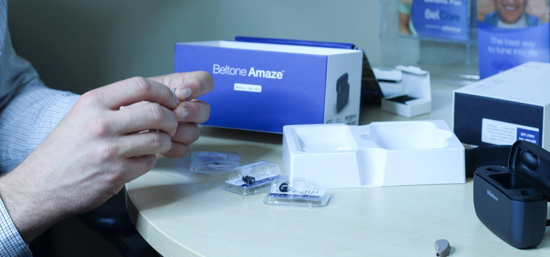 Hearing aid expert making hearing aid adjustments