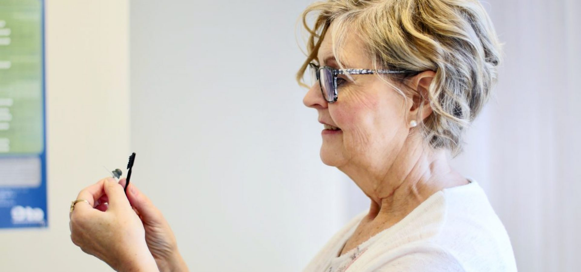 Cleaning hearing aids at Fraser Valley Beltone