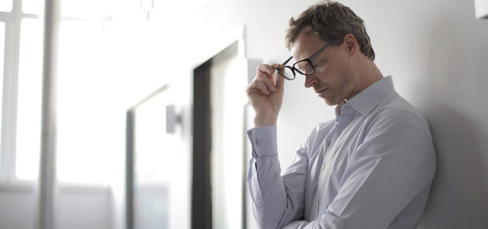 Man looking stressed leading to hearing loss and tinnitus