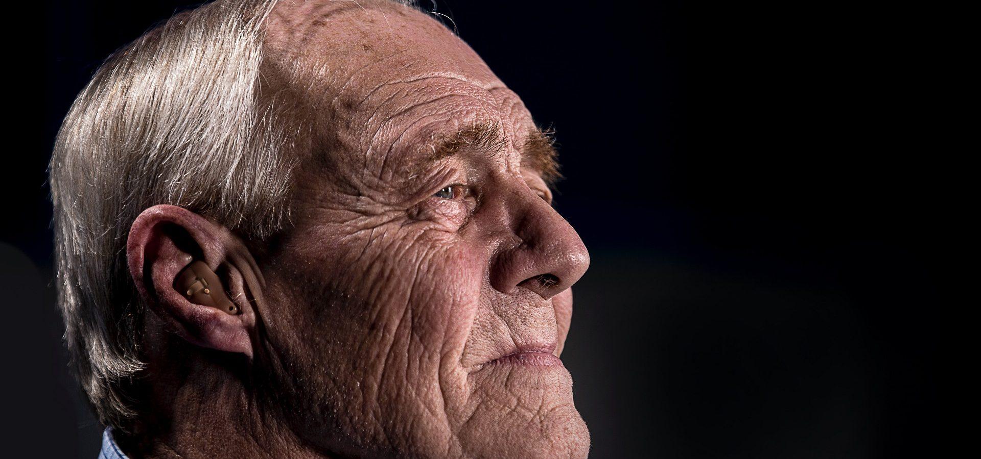 Senior man with a hearing aid