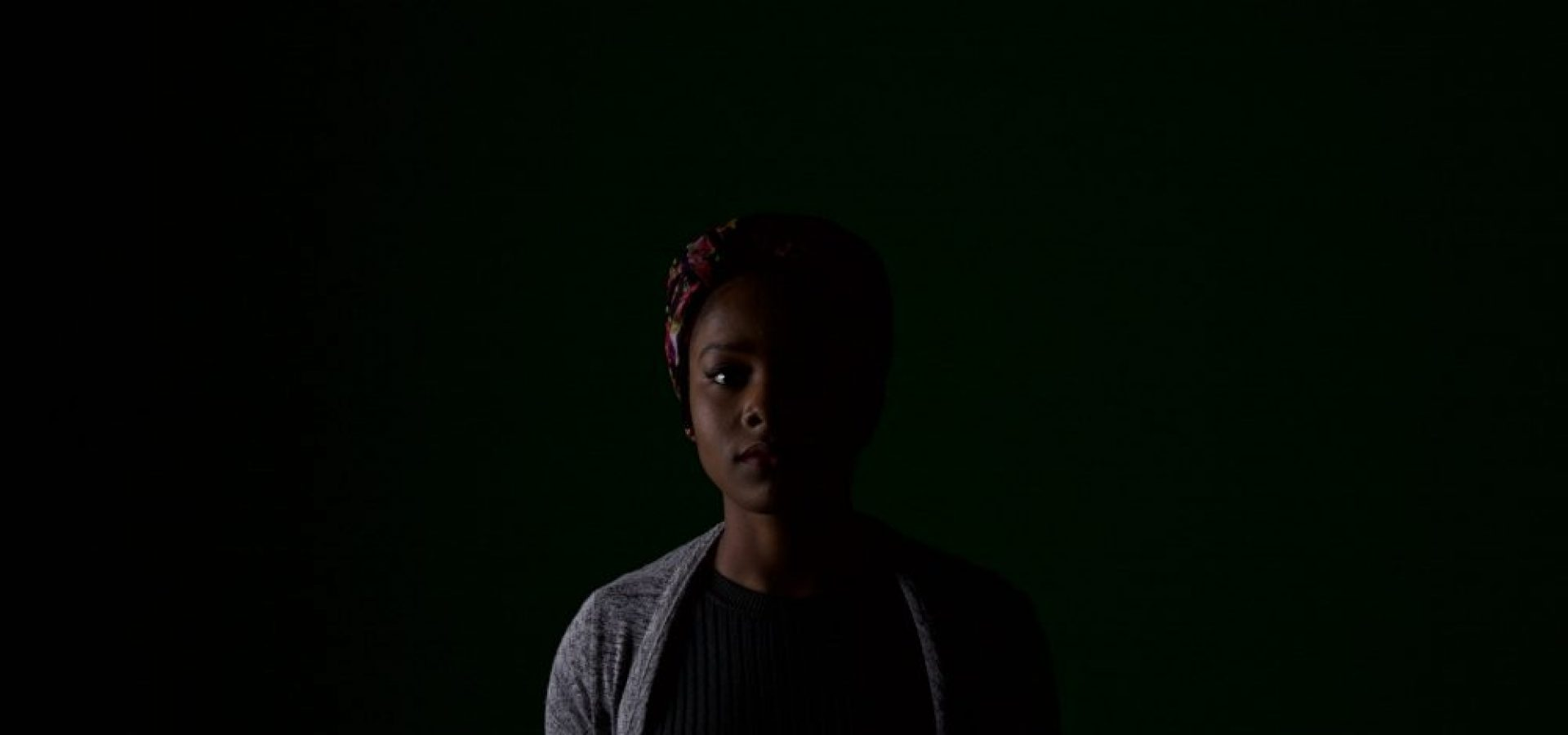 Half of woman hidden by darkness. Captures the feeling of single sided deafness