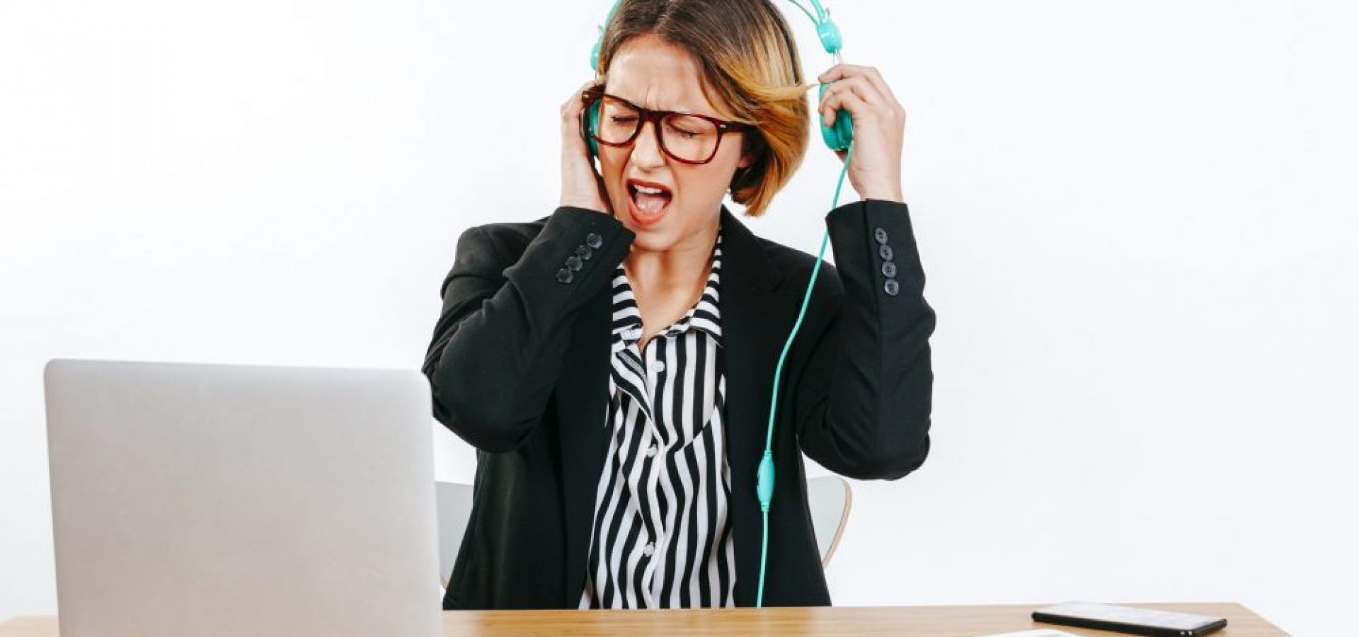 Woman in headphones suffering from loudness